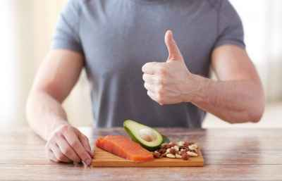 thumbs-up-man-with-salmon-avocado-and-almonds