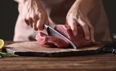 slicing-big-steak-with-knife