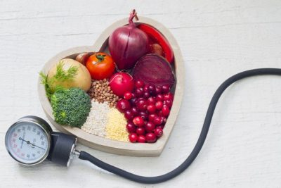 blood-pressure-monitor-and-veggies-in-heart-shaped-bowl