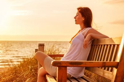 woman-meditating-and-relaxing-by-the-seaside